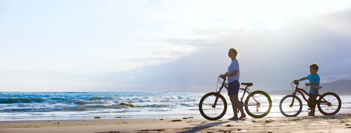 Mother and daughter cycling on EU beach